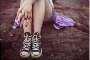 Sitting Teenage Girl with Converse Shoes
